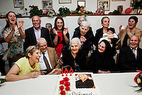 "PERDASDEFOGU, SARDINIA, ITALY - 30 JUNE 2013: Claudina Melis (center, sitting next to her siblings - from left to right - Antonio, Consolata and Vitalio) is about to blow the candles for her 100th birthday in Perdasdefogu, Italy, on June 30th 2013.<br /> <br /> Last year, the Melis family entered the Guinness Book of World Records for having the highest combined age of any nine living siblings on earth — today more than 825 years. The youngest sibling, Mafalda – the ""little one"" – is 79 years old.<br /> <br /> The Melis siblings were all born in Perdasdefogu to Francesco Melis and Eleonora Mameli, who had a general store. Consolata, 106, is the oldest, then Claudia, 100; Maria, 98; Antonino, 94; Concetta, 92; Adolfo, 90; Vitalio, 87; Fida Vitalia, 81; and Mafalda, the baby at 79. Their descendants now account for about a third of the village."