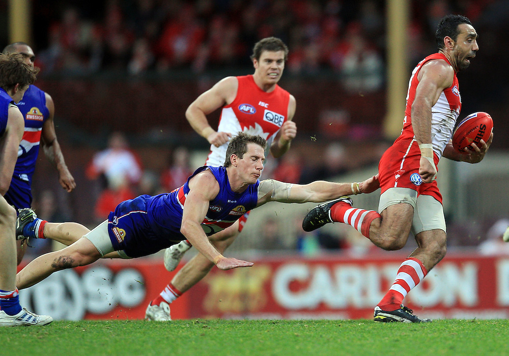Dale Morris of the Bulldogs dives at Adam Goodes of the Swans during the AFL Round 18 match between the Sydney Swans and the Western Bulldogs at the SCG, Sydney.