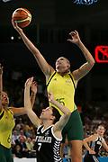 23/03/2006. Melbourne 2006 Commonwealth Games. Day 8 Womens Basketball Gold Medal Game. Australia v New Zealand. Lauren Jackson Australia towers over Micaela Cocks.