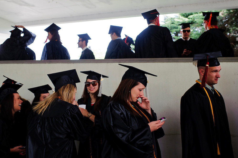 Graduates of the Ohio University 2013 undergraduate class wait in line to proceed into the Convocation Center during the morning commencement ceremony, Saturday, May 4, 2013.