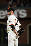 San Francisco Giants starting pitcher Chris Stratton (34) grimaces after being hit in the back by a Milwaukee Brewers hit at AT&T Park in San Francisco, California, on August 21, 2017. (Stan Olszewski/Special to S.F. Examiner)