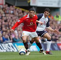 Photo: Leigh Quinnell.<br /> Tottenham Hotspur v Manchester United. The Barclays Premiership. 17/04/2006. Man Utds' Cristiano Ronaldo keeps the ball from Tottenhams Paul Stalteri.