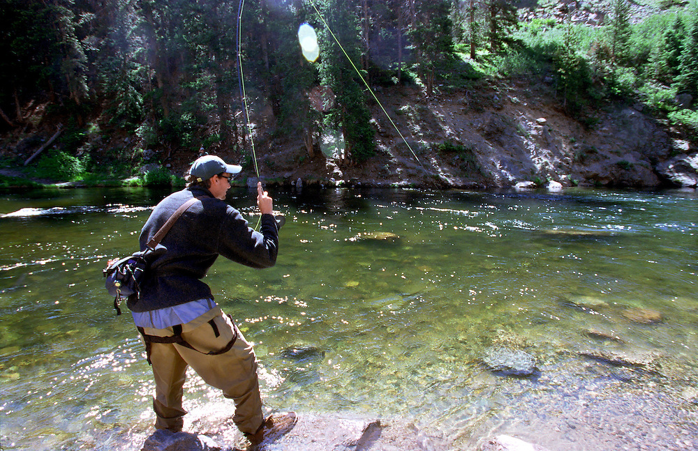 A flyfisherman fights a fish on the Taylor River in Colorado