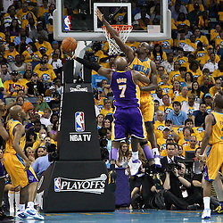 April 22, 2011; New Orleans, LA, USA; Los Angeles Lakers power forward Lamar Odom (7) shoots over New Orleans Hornets center Emeka Okafor (50)  during the second quarter in game three of the first round of the 2011 NBA playoffs at the New Orleans Arena.    Mandatory Credit: Derick E. Hingle