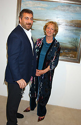 Artist PRINCESS AZAMAT GUIREY and ADRIAN SASSOON at an exhibition of art by Bo Sigrist Guirey (Princess Azamat Guirey) held at Square One Gallery, 592 Kings Road, London SW6 on 13th December 2005.<br />
