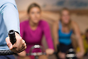 Women Working Out on Exercise Bicycles at Gym