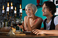 Couple sitting at dining table close up