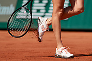 Paris, France - 2017 June 01: Agnieszka Radwanska from Poland cleans shoes during her women's single match second round during tennis Grand Slam tournament The French Open 2017 (also called Roland Garros) at Stade Roland Garros on June 01, 2017 in Paris, France.<br /> <br /> Mandatory credit:<br /> Photo by © Adam Nurkiewicz<br /> <br /> Adam Nurkiewicz declares that he has no rights to the image of people at the photographs of his authorship.<br /> <br /> Picture also available in RAW (NEF) or TIFF format on special request.<br /> <br /> Any editorial, commercial or promotional use requires written permission from the author of image.