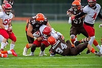 KELOWNA, BC - AUGUST 17:  Lucas Spencer #70 and Jonah Williams #34 of Okanagan Sun tackle a player of the Westshore Rebels  at the Apple Bowl on August 17, 2019 in Kelowna, Canada. (Photo by Marissa Baecker/Shoot the Breeze)