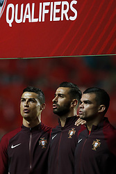 October 10, 2017 - Lisbon, Portugal - Portugal's forward Cristiano Ronaldo (L) , Portugal's goalkeeper Rui Patricio (C) and Portugal's defender Pepe   sing the Portuguese  national anthem during the FIFA World Cup WC 2018 football qualifier match between Portugal and Switzerland, in Lisbon, on October 10, 2017. (Credit Image: © Carlos Palma/NurPhoto via ZUMA Press)