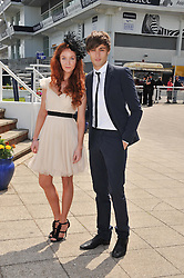 Actress OLIVIA GRANT and actor DOUGLAS BOOTH at the Investec Derby at Epsom Racecourse, Epsom Downs, Surrey on 4th June 2011.