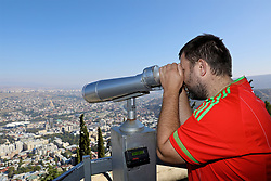 TBILSI, GEORGIA - Friday, October 6, 2017: A Wales supporter looks out from Mtatsminda Park across Tbilisi ahead of the 2018 FIFA World Cup Qualifying Group D match between Georgia and Wales. (Pic by David Rawcliffe/Propaganda)