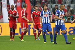 26.10.2013, Allianz Arena, Muenchen, GER, 1. FBL, FC Bayern Muenchen vs Hertha BSC Berlin, 10. Runde, im Bild l-r: Torjubel von David ALABA #27 (FC Bayern Muenchen), Bastian SCHWEINSTEIGER #31 (FC Bayern Muenchen), Mario GOETZE #19 (FC Bayern Muenchen), enttaeuschung bei Hajime HOSOGAI #7 (Hertha BSC), Aenis BEN-HATIRA #10 (Hertha BSC) // during the German Bundesliga 10th round match between FC Bayern Munich and Hertha BSC Berlin at the Allianz Arena in Muenchen, Germany on 2013/10/26. EXPA Pictures © 2013, PhotoCredit: EXPA/ Eibner-Pressefoto/ Kolbert<br /> <br /> *****ATTENTION - OUT of GER*****