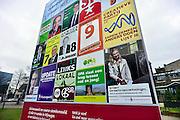 Nederland, Nijmegen, 20-2-2014Vierkiezingscampagne van partijen voor de lokale verkiezingen. Verschillende lokale partijen doen mee. Het bord is voorbedrukt door bordbusters zodat iedereen dezelfde ruimte heeft.Foto: Flip Franssen/Hollandse Hoogte