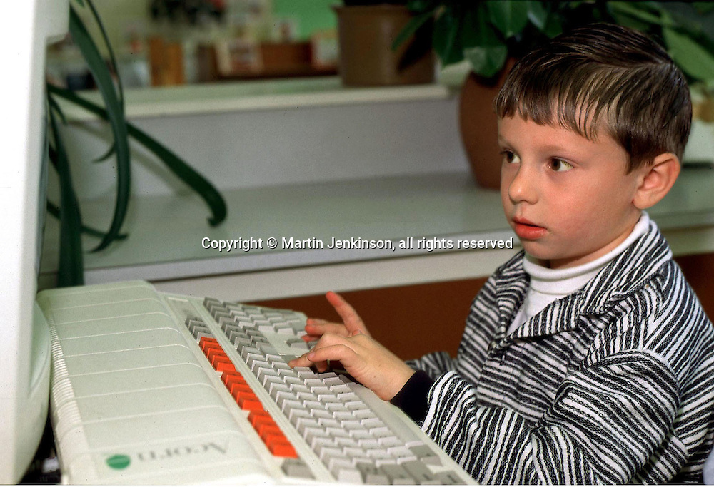 Nursery school pupil using a computer......© Martin Jenkinson tel 0114 258 6808  mobile 07831 189363 email martin@pressphotos.co.uk  NUJ recommended terms & conditions apply. Copyright Designs & Patents Act 1988. Moral rights asserted credit required. No part of this photo to be stored, reproduced, manipulated or transmitted by any means without prior written permission.