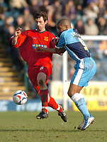 Photo: Leigh Quinnell.<br /> Wycombe Wanderers v Shrewsbury Town. Coca Cola League 2. 11/03/2006. Shrewsburys Neil Sorvel holds off Wycombes  Jermaine Easter.