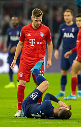 MUNICH, GERMANY - Wednesday, December 11, 2019: Tottenham Hotspur's Giovani Lo Celso goes down after an altercation with Bayern Munich's Joshua Kimmich during the final UEFA Champions League Group B match between FC Bayern München and Tottenham Hotspur FC at the Allianz Arena. (Pic by David Rawcliffe/Propaganda)