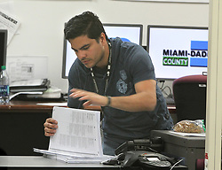 Miami-Dade County Election department staff members work on the recount process of the county's November 6 elections at the elections department in Doral, Fla., on Saturday, November 10, 2018. Photo by Pedro Portal/Miami Herald/TNS/ABACAPRESS.COM