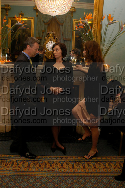 Duncan Kenworth, Kristin Scott Thomas and Emmanuelle Devos. The Renault French Film season 2005 Press launch. Institute of Directors. 116 Pall Mall. London Sw1. 31 March 2005. ONE TIME USE ONLY - DO NOT ARCHIVE  © Copyright Photograph by Dafydd Jones 66 Stockwell Park Rd. London SW9 0DA Tel 020 7733 0108 www.dafjones.com
