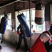 In early hours of the day, several fighters start their training at the Hillbrow Boxing Club, in Johannesburg.