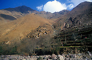 Berber village and farm terrace on steep mountain side, Atlas Mountains, near Imlil, Morocco
