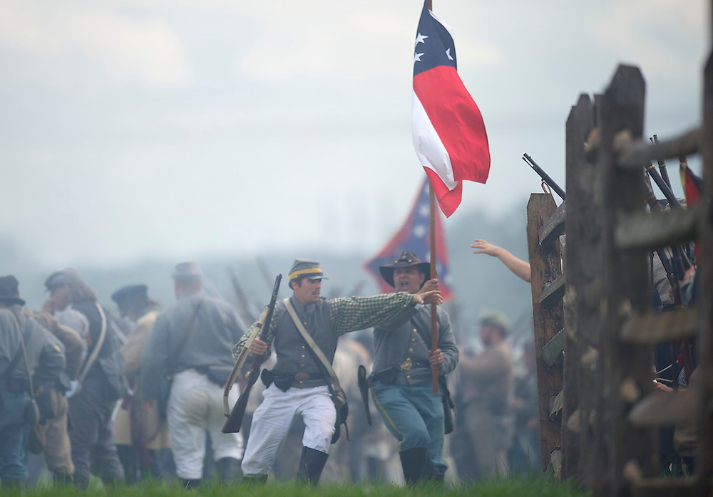 Confederate soldiers march through a fence during a staging of Pickett's Charge the finale of a four day Gettysburg Anniversary Committee 150th Gettysburg reenactment in Gettysburg, PA on July 7, 2013.
