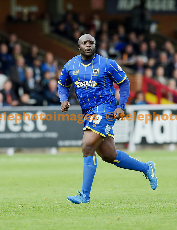Bayo Akinfenwa of Wimbledon nicknamed 'The Beast' during the Sky Bet League 2 match between AFC Wimbledon and Morecambe at the Cherry Red Records Stadium in Kingston. October 17, 2015.<br /> Simon  Dack / Telephoto Images<br /> +44 7967 642437
