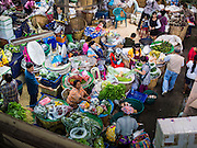 21 OCTOBER 2014 - BANGKOK, THAILAND:  A child in the midst of a group of vendors in the Pak Khlong Talat market on the Chao Phraya River in Bangkok.   PHOTO BY JACK KURTZ