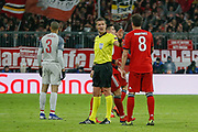Referee Daniele Orsato gestures to Bayern Munich defender Javi Martinez (8) during the Champions League match between Bayern Munich and Liverpool at the Allianz Arena, Munich, Germany, on 13 March 2019.