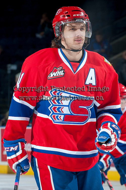 KELOWNA, CANADA -JANUARY 29: Liam Stewart C #11 of the Spokane Chiefs skates during warm up against the Kelowna Rockets on January 29, 2014 at Prospera Place in Kelowna, British Columbia, Canada.  Stewart is the son of rock star, Rod Stewart and Sports Illustrated swimsuit model Rachel Hunter. (Photo by Marissa Baecker/Getty Images)  *** Local Caption *** Liam Stewart;