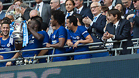 Football - 2018 FA Cup Final - Chelsea vs. Manchester United<br /> <br /> Antonio Conte, Manager of Chelsea FC, looks on as the FA cup is passed to the other players at Wembley Stadium.<br /> <br /> COLORSPORT/DANIEL BEARHAM