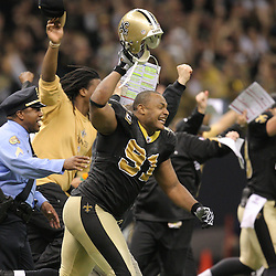 Jan 24, 2010; New Orleans, LA, USA; New Orleans Saints defensive end Will Smith (91) rushes the field with teammates following an overtime victory over the Minnesota Vikings in e 2010 NFC Championship game at the Louisiana Superdome. Mandatory Credit: Derick E. Hingle-US PRESSWIRE