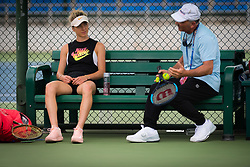 September 22, 2018 - Elina Svitolina of the Ukraine listens to Nick Saviano at the 2018 Dongfeng Motor Wuhan Open WTA Premier 5 tennis tournament (Credit Image: © AFP7 via ZUMA Wire)