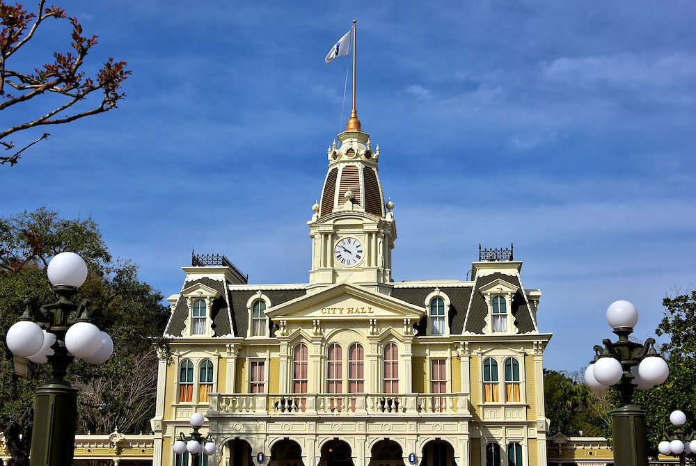 City Hall on Main Street U.S.A. at Magic Kingdom in Orlando, Florida<br /> On the left as you enter Magic Kingdom is City Hall. Inside are the Guest Relations services. The well-trained hosts can answer your questions, provide information regarding events and attractions plus provide maps in several languages. This is also the lost and found office. If you are celebrating a birthday, ask for a button to get special treatment by cast members. In front of this Victorian building is Town Square. This is where you can board one of several vehicles such as a horse-drawn street car, double-decker bus, horseless car or fire engine. Then you can make a grand entrance down Main Street U.S.A.