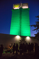 London, UK. 14 June, 2019. Members of the Grenfell community leave tributes beneath the Grenfell Tower following the Grenfell Silent Walk on the second anniversary of the fire on 14th June 2017 in which 72 people died and over 70 were injured.