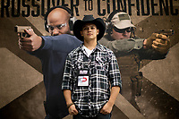 AJ Jackson , 26,  of San Antonio, Tx poses for a photo at the NRA's annual exposition at the Kay Bailey Hutchison Convention Center on Friday, May 4, 2018, in Dallas.  This was Jackson's first NRA exposition to attend.