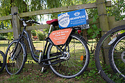 """Henley on Thames, United Kingdom, 23rd June 2018, Saturday,   """"Henley Women's Regatta"""",  view, Cycles, Bicyles parked and chained to the Wooden Fence on Fawley Meadow, Henley Reach, River Thames, England, © Peter SPURRIER/Alamy Live News"""