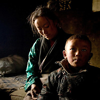 Nanka of 24 and her son Tsewanq Dhundup of 3 years old,  are affected by the Kashin-Beck Disease. Well know as well as the Big bone Disease,  one of the effects of this is that the people can not grow normally, and they stay short and has allot of troubles to walk normally..Narme, Tibet, China. April 14, 2007. Photo: Bernardo De Niz
