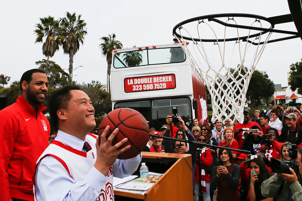 Redondo Mayor Mike Gin goes up for a shot with Coach Reggie Morris and Members of the Redondo Union High School Seahawk Basketball team celebrate their CIF Division 2 State Basketball championship during a parade on top of a double decker bus, Thursday, March 28, 2013 in Redondo Beach, Calif. © 2013 Patrick T. Fallon. *NO USE WITHOUT PERMISSION*
