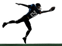 one  american football player man scoring touchdown in silhouette studio isolated on white background