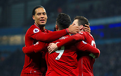 Liverpool's Roberto Firmino (centre) celebrates scoring his side's first goal of the game Liverpool's Virgil van Dijk (centre) and Liverpool's Andrew Robertson
