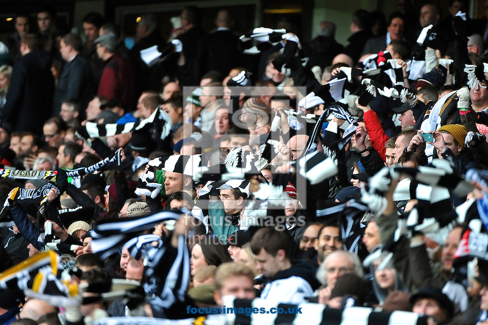 Picture by Ian Wadkins/Focus Images Ltd +44 7877 568959<br /> 05/01/2014<br /> Derby County fans wave scarves ahead of the The FA Cup match at the Ipro Stadium, Derby.