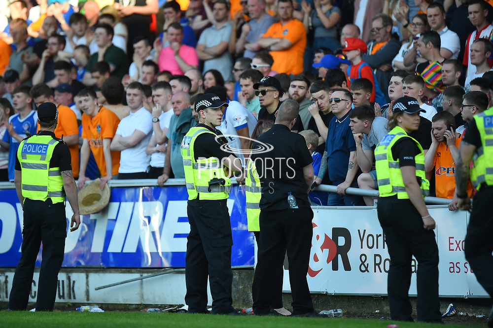The Police line up in front of the Oldham fans during the EFL Sky Bet League 1 match between Northampton Town and Oldham Athletic at Sixfields Stadium, Northampton, England on 5 May 2018. Picture by Dennis Goodwin.