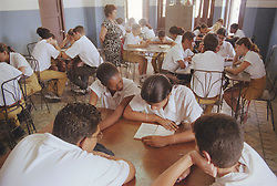 Secondary school children studying in classroom,