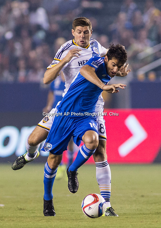 Montreal Impact midfielder Ignacio Piatti, front, and   Los Angeles Galaxy midfielder Steven Gerrard battle for a ball in the first half of an MLS soccer game StubHub Center in Carson, Calif., Saturday, Sept. 12, 2015. (AP Photo/Ringo H.W. Chiu)