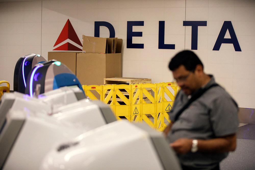 A customer checks in as barriers and boxes stand in front of Delta signage in Terminal 5 as the airline relocation begins at Los Angles International Airport (LAX) on Friday, May 12, 2017 in Los Angeles, Calif. Delta Airlines will move from Terminals 5 and 6 to Terminals 2 and 3, forcing 19 other carriers to shift their operations into the facilities vacated by Delta.  © 2017 Patrick T. Fallon