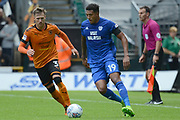 Wolverhampton Wanderers defender Barry Douglas (3) holds up Cardiff City midfielder Nathaniel Mendez-Laing (19) 0-0 during the EFL Sky Bet Championship match between Wolverhampton Wanderers and Cardiff City at Molineux, Wolverhampton, England on 19 August 2017. Photo by Alan Franklin.