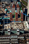 Nederland, Zuid-Holland, Den Haag, 20-03-2009; het dubbelministerie Justitie en Binnenlandse zaken in aanbouw, JuBi, bouwput met bouwkranen. Onder in beeld in beeld het Bernhardviaduct met overkluizing, boven de dubbele torens van Castalia, bijgenaamd de Haagse Tieten (ministerie VWS). View on The Hague. The cranes of the construction site of the two Ministries of Justice and Interior. The blue roofed twin buildings are called The Tits of The Hague, residence of the Ministry of Health. .Swart collectie, luchtfoto (toeslag); Swart Collection, aerial photo (additional fee required); .foto Siebe Swart / photo Siebe Swart