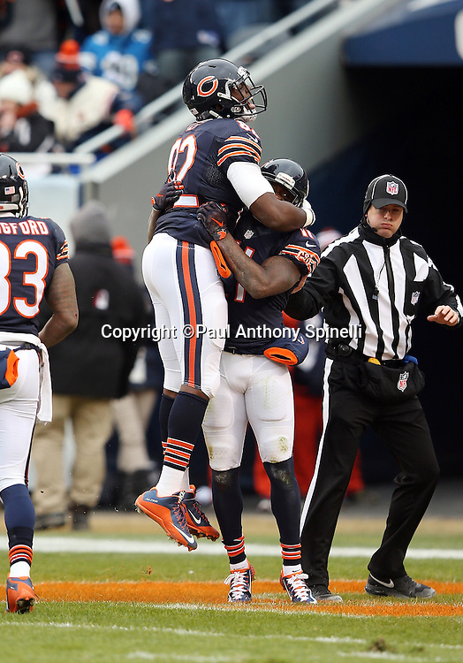 Chicago Bears rookie tight end Khari Lee (82) leaps and celebrates with Chicago Bears wide receiver Josh Bellamy (11) after Bellamy catches a 34 yard touchdown pass in the end zone that ties the third quarter score at 10-10 during the NFL week 17 regular season football game against the Detroit Lions on Sunday, Jan. 3, 2016 in Chicago. The Lions won the game 24-20. (©Paul Anthony Spinelli)