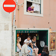 The coexistence of Bica's bohemian side with its more traditional inhabitants.